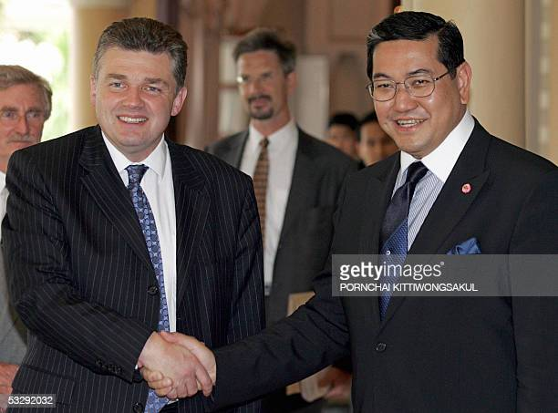Thai Deputy Prime Minister Surakiart Sathirathai welcomes British Foreign Office Minister Ian Pearson at a Government House in Bangkok 27 July 2005...
