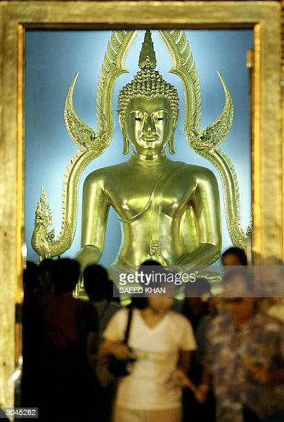 Thai devotees pray during a special worship to celebrate the Makha Pucha Day Buddhist festival at a famous Marble Temple in Bangkok 05 March 2004...