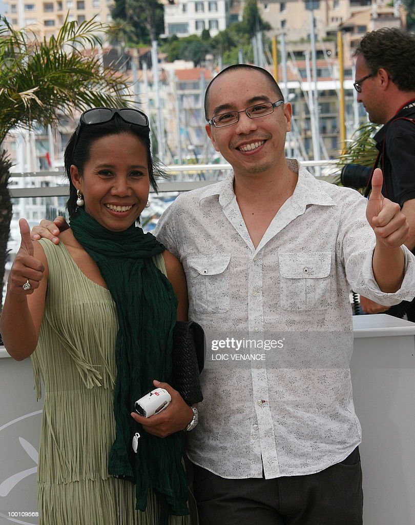 Thai director Apichatpong Weerasethakul (R) and Thai actress Wallapa Mongkolprasert pose during the photocall 'Lung Boonmee Raluek Chat' (Uncle Boonmee Who Can Recall His Past Lives) presented in competition at the 63rd Cannes Film Festival on May 21, 2010 in Cannes.