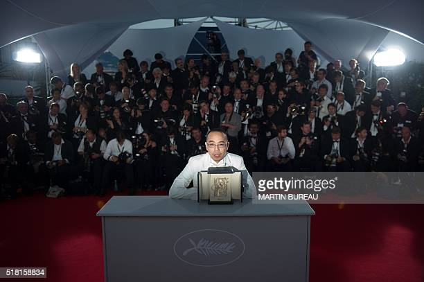 Thai director Apichatpong Weerasethakul poses after receiving the Palm dOr award for his film 'Lung Boonmee Raluek Chat' during the photocall of the...