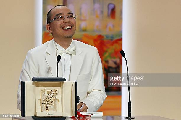 Thai director Apichatpong Weerasethakul poses after receiving the Palm dOr award for his film 'Lung Boonmee Raluek Chat' during the closing ceremony...