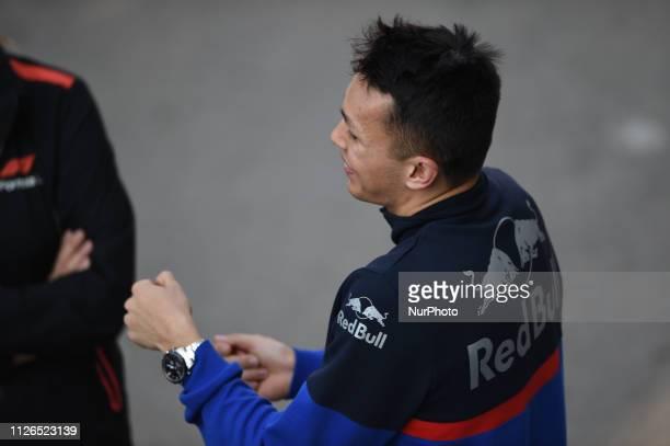Thai driver Alexander Albon of Italian team Red Bull Toro Rosso Honda speaking driving sensation on his singleseater STR14 during Barcelona winter...