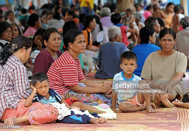 Thai elder villagers gather at temporary camp as they evacuate from their homes following a deadly exchange of gunfire between Thai and Cambodian...