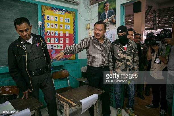 Thai election official negotiates with a protester as advanced voting for the February 2nd general elections was unable to continue due to...