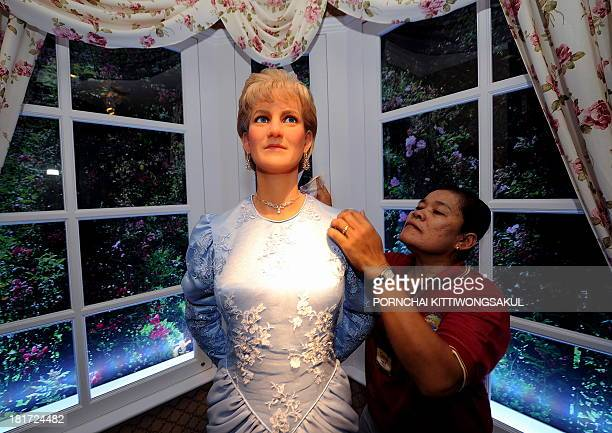 A Thai employee cleans the wax model of Princess Diana displayed at the Louis Toussaud's Waxworks in Pattaya on November 13 2009 Tussaud's Waxworks a...