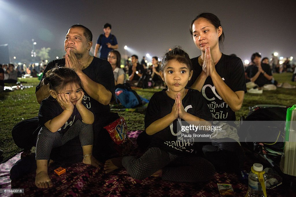 A Thai family prays during a memorial ceremony near the Royal palace on October 18, 2016 in Bangkok, Thailand. Thailand's King Bhumibol Adulyadej, the world's longest-reigning monarch, died at the age of 88 in Bangkok's Siriraj Hospital on Thursday after his 70-year reign. The Crown Prince Maha Vajiralongkorn had asked for time to grieve the loss of his father before becoming the next king as nation waits for the coronation date.