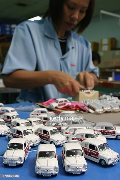 Thai female factory worker on the production line in a toy factory owned by French company Majorette one of France's leading manufacturers of toys...