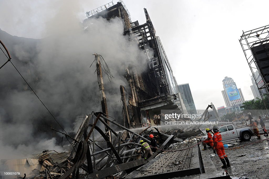 Thai firemen try to douse the flames at Thailand's biggest shopping mall - Central World - after it was set ablaze the day before following an army assault on an anti-government protest site in downtown Bangkok on May 20, 2010. Thailand's biggest shopping mall faces collapse after it was set ablaze by enraged protesters in the wake of an army offensive to shut down an anti-government rally, police said. AFP PHOTO/Christophe ARCHAMBAULT