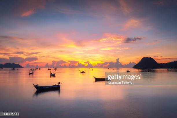 thai fishing boat used as a vehicle for finding fish in the sea.at sunrise - prachuap khiri khan province stock pictures, royalty-free photos & images