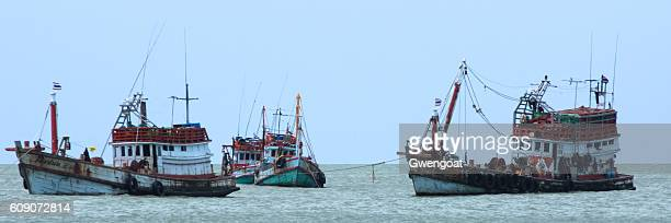 thai fishing boats - gwengoat stock pictures, royalty-free photos & images