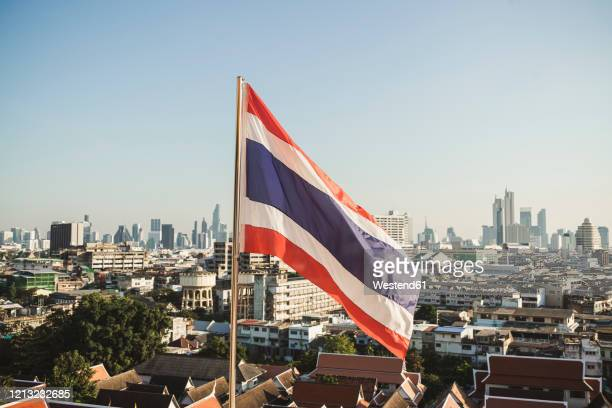 thai flag and view to the city, bangkok, thailand - identity politics stock pictures, royalty-free photos & images