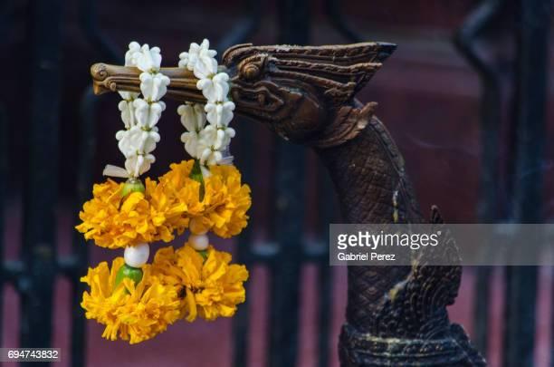 a thai floral garland - エラワン聖堂 ストックフォトと画像