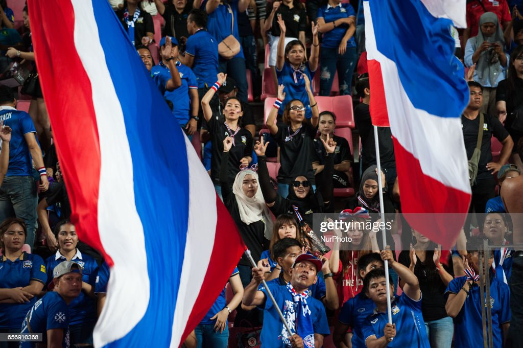 Thai football fans cheer their team during the 2018 FIFA World Cup Qualifier Group B match between Thailand and Saudi Arabia at the Rajamangala National Stadium in Bangkok, Thailand, on March 23, 2017.