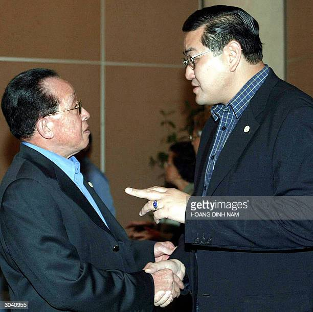 Thai Foreign Minister Surakiart Sathirathai chats with his Cambodian counterpart Hor Namhong on the sideline of the annual retreat of ASEAN foreign...