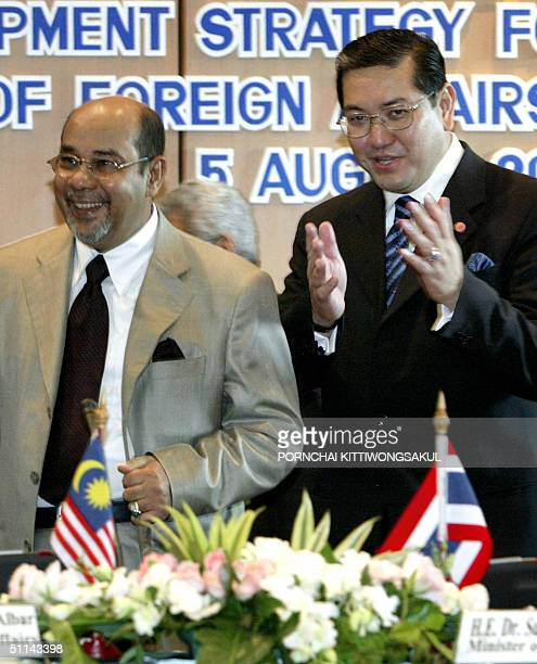 Thai Foreign Minister Surakiart Sathirathai gestures as he talks with Malaysian Foreign Minister Syed Hamid Albar at the foreign ministry in Bangkok...