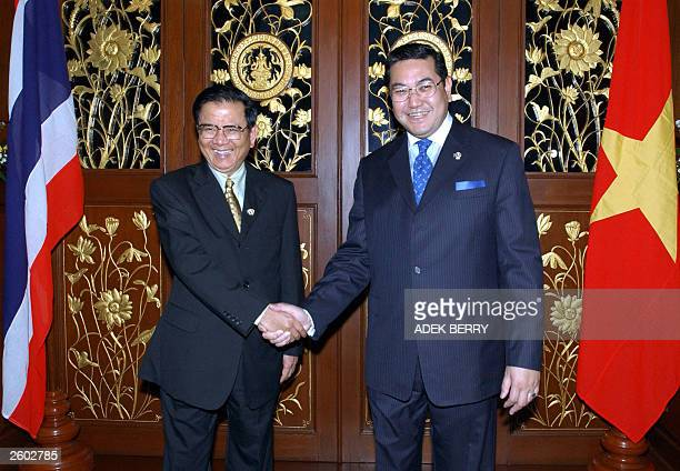 Thai Foreign Minister Surakiart Sathirathai shakes hand with his counterpart of Vietnam Foreign Minister Nguyen Dy Nien at Foreign Ministry Office in...