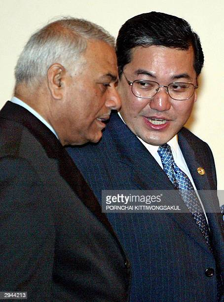 Thai Foreign Minister Surakiart Sathirathai talks with India Foreign Minister Yashwant Sinha during the opening ceremony of the 6th BIMSTEC...