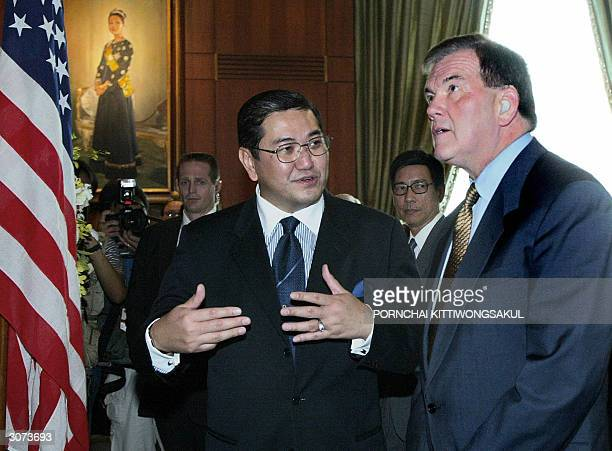 Thai Foreign Minister Surakiart Sathirathai talks with US Secretary of Homeland Security Tom Ridge during the signing ceremony at the foreign...