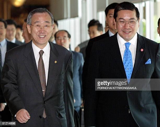 Thai Foreign Minister Surakiart Sathirathai walks with his South Korean counterpart Ban KiMoon at the Foreign Ministry in Bangkok 25 August 2004 Ban...