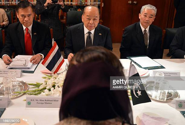 Thai Foreign Minister Surapong Tovichakchaikul listens to Pakistani Foreign Minister Hina Rabbani Khar during a meeting in Islamabad on January 10...