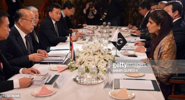 Thai Foreign Minister Surapong Tovichakchaikul speaks with Pakistani Foreign Minister Hina Rabbani Khar during a meeting in Islamabad on January 10...