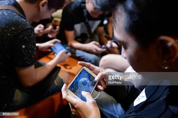 Thai gamers play Garena RoV Thailand game on their mobile phones at the King of Gamers Electronic Sports competition event in Bangkok Thailand 16...