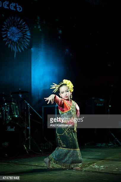 Thai girl dressed in a Lanna costume performs a traditional dance during Loy Krathong Festival