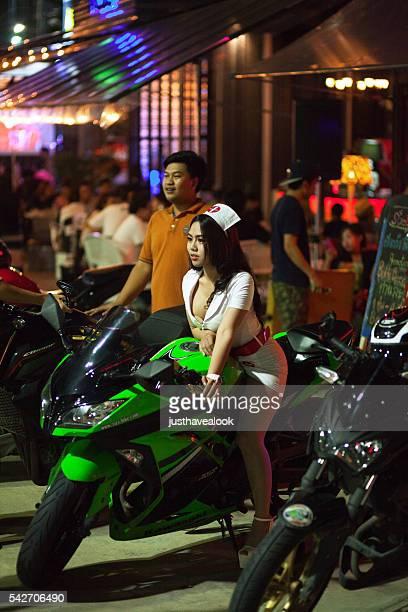 Thai girl sitting on motorcycle
