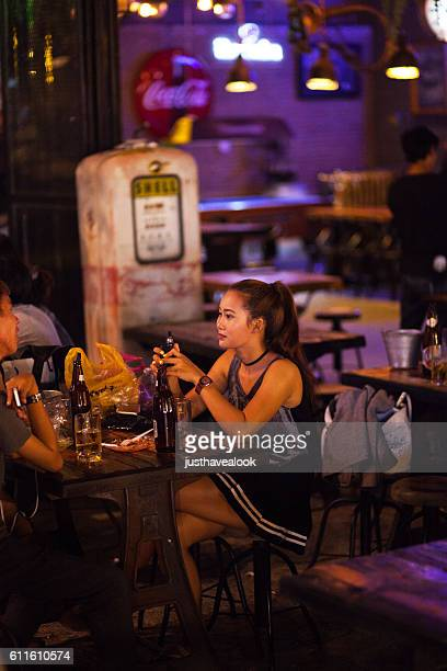 thai girl with e-cigarette and drinks - little girl smoking cigarette stock photos and pictures