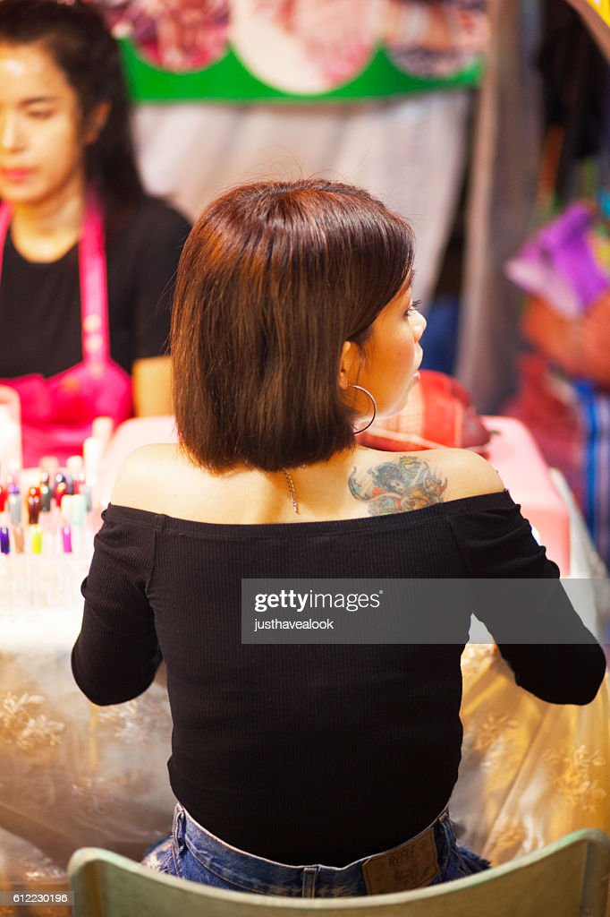 Thai Girl With Tattoo Getting Manicure Stock Photo