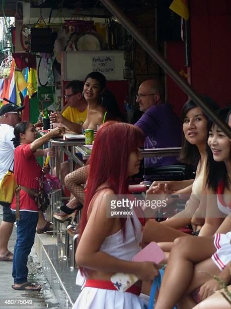 thai girls along soi 6, pattaya thailand - thailand prostitutes stock photos and pictures
