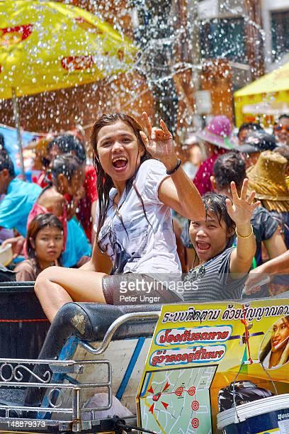Thai girls having fun at Songkran Water Festival.