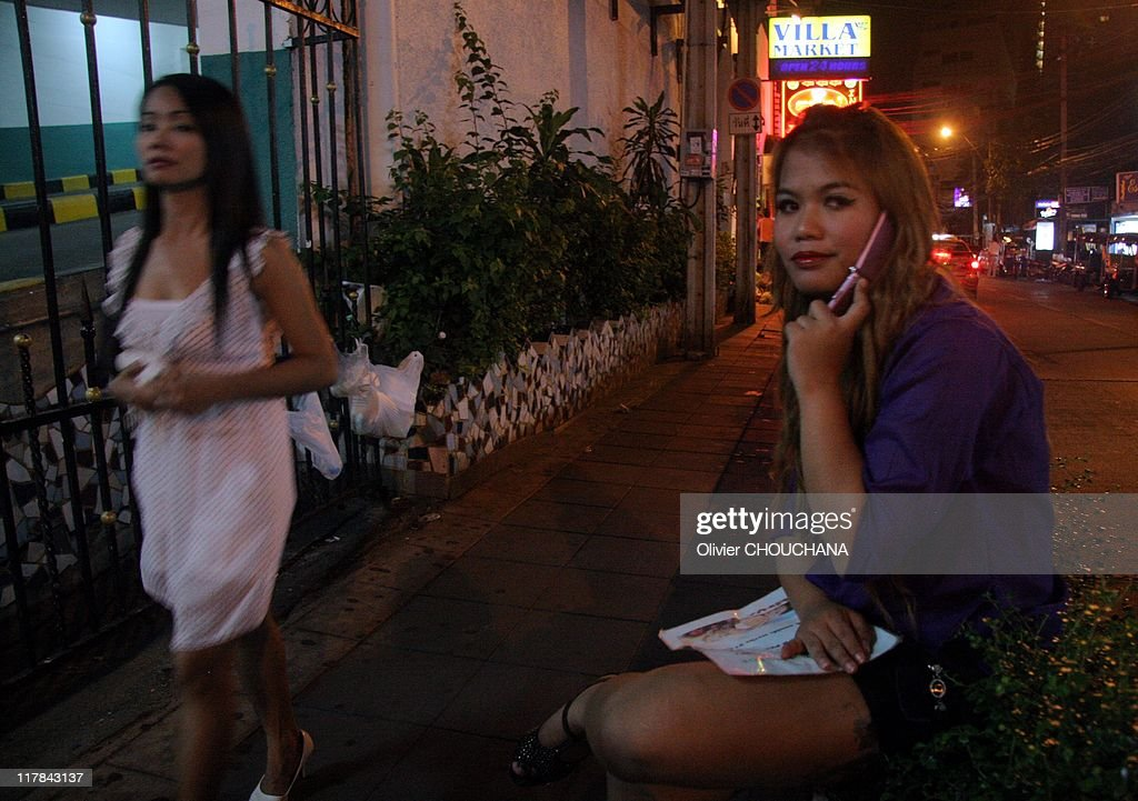 Thai girls providing massage services wait for customers in