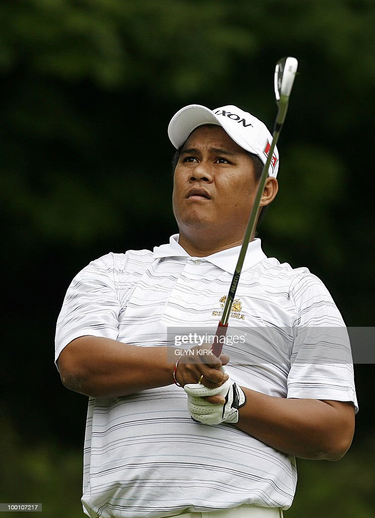 Thai golfer Chapchai Nirat watches his drive from the 2nd tee on the first day of the PGA Championship on the West Course at Wentworth, central England on May 20, 2010.