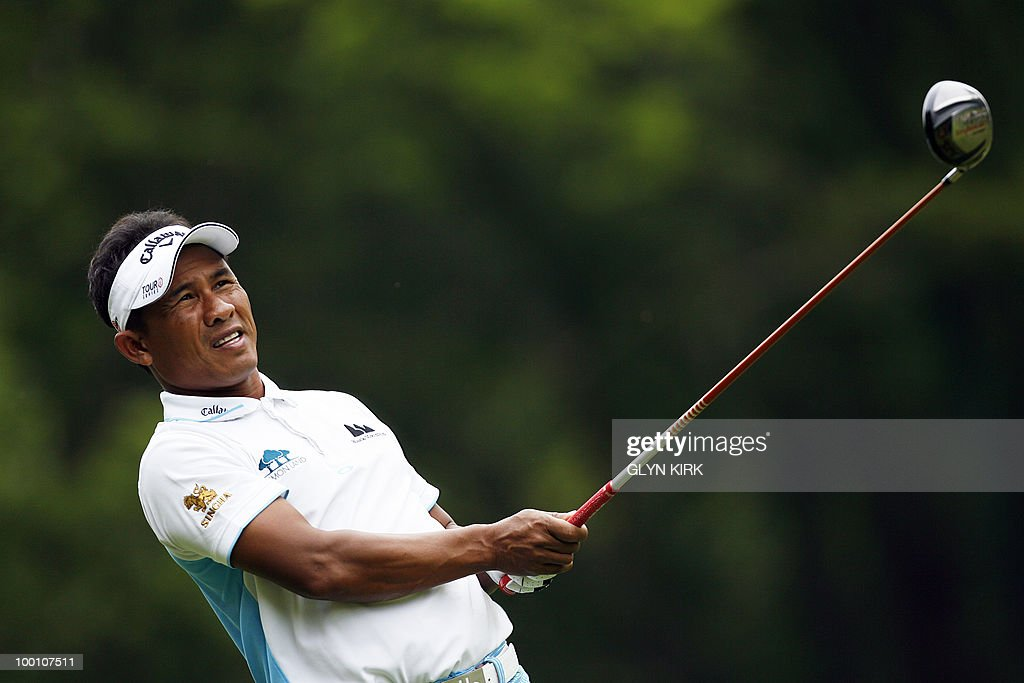 Thai golfer Thongchai Jaidee watches his drive from the 3rd tee during the first day of the PGA Championship on the West Course at Wentworth, England, on May 20, 2010.