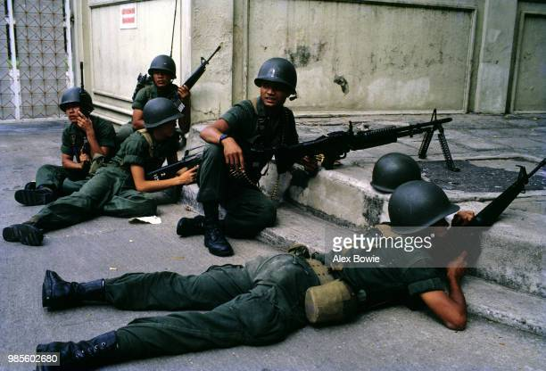 Thai government soldiers take up defensive positions in the streets of Bangkok during the failed coup attempt, Bangkok, 9th September 1985.