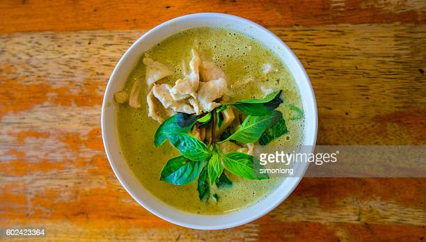 Thai Green Curry Served In Bowl On Table
