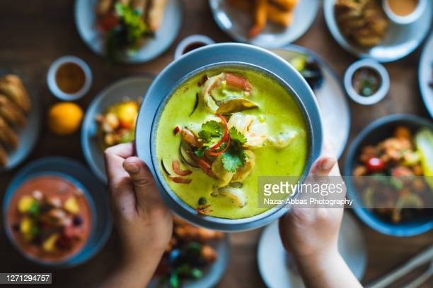 thai green seafood coconut curry. - ingredient stock pictures, royalty-free photos & images