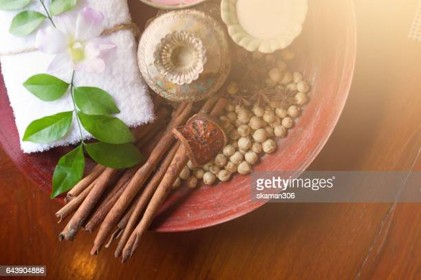 Thai herb and salt with towel on wooden plate ingredient for theraphy
