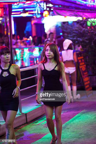 thai hooker wearing black dress in soi cowboy - thailand prostitutes stock photos and pictures