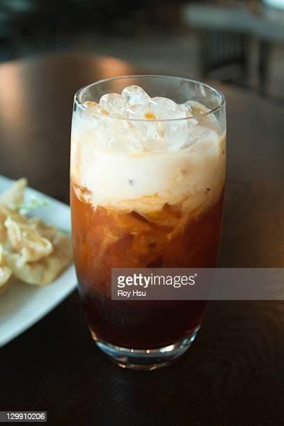 Thai iced tea on table