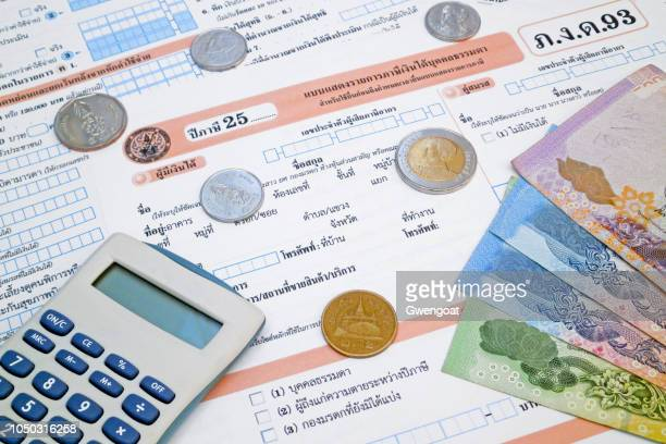 thai income tax form - gwengoat stock pictures, royalty-free photos & images