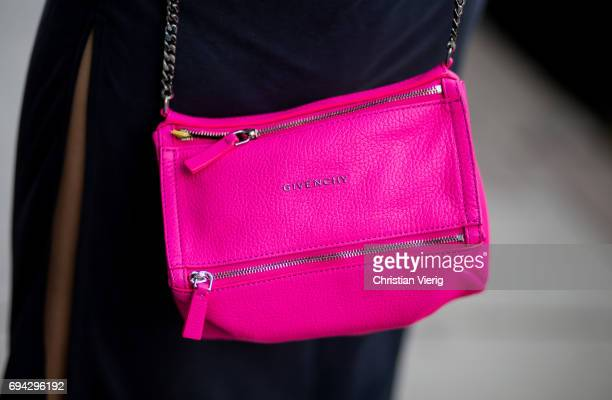 Thai Janie Tienphosuwan actress and model wearing a leather jacket pink Givenchy bag during the London Fashion Week Men's June 2017 collections on...