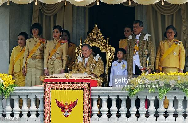 Thai King Bhumibol Adulyadej is surrounded by his daughters Princesses Ubol Ratana Chulabhorn Sirindhorn his son Prince Maha Vajiralongkorn and his...