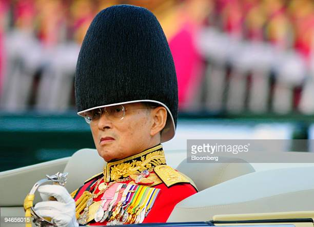 Thai King Bhumibol Adulyadej rides in an open car during a military parade in Bangkok Thailand on Sunday Dec 2 2007 King Bhumibol is revered as a...