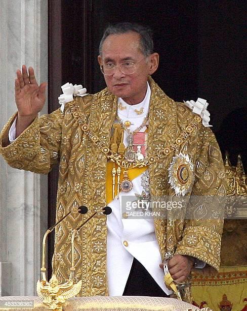 Thai King Bhumibol Adulyadej waves to his people after his address in Bangkok, 09 June 2006. Thai King Bhumibol Adulyadej called for unity among his...