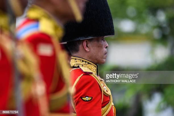 Thai King Maha Vajiralongkorn attends the funeral procession of his father the late Thai King Bhumibol Adulyadej in Bangkok on October 26 2017 A sea...