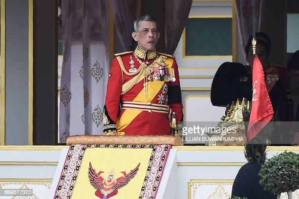 Thai King Maha Vajiralongkorn attends the funeral procession of the late Thai king Bhumibol Adulyadej in Bangkok on October 26, 2017. - A sea of...