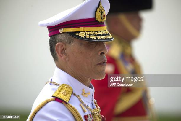 Thai king Maha Vajiralongkorn marches behind the chariots carrying the ashes of his father the late Thai king Bhumibol Adulyadej during the funeral...
