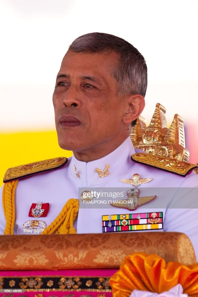 Thai King Maha Vajiralongkorn presides over the annual royal ploughing ceremony outside Bangkok's royal palace on May 14, 2018. - Thai palace astrologers predicted a bountiful harvest and a year of good trade on May 14 after sacred oxen munched on grass and drank water and liquor in an ancient royal ploughing ceremony.